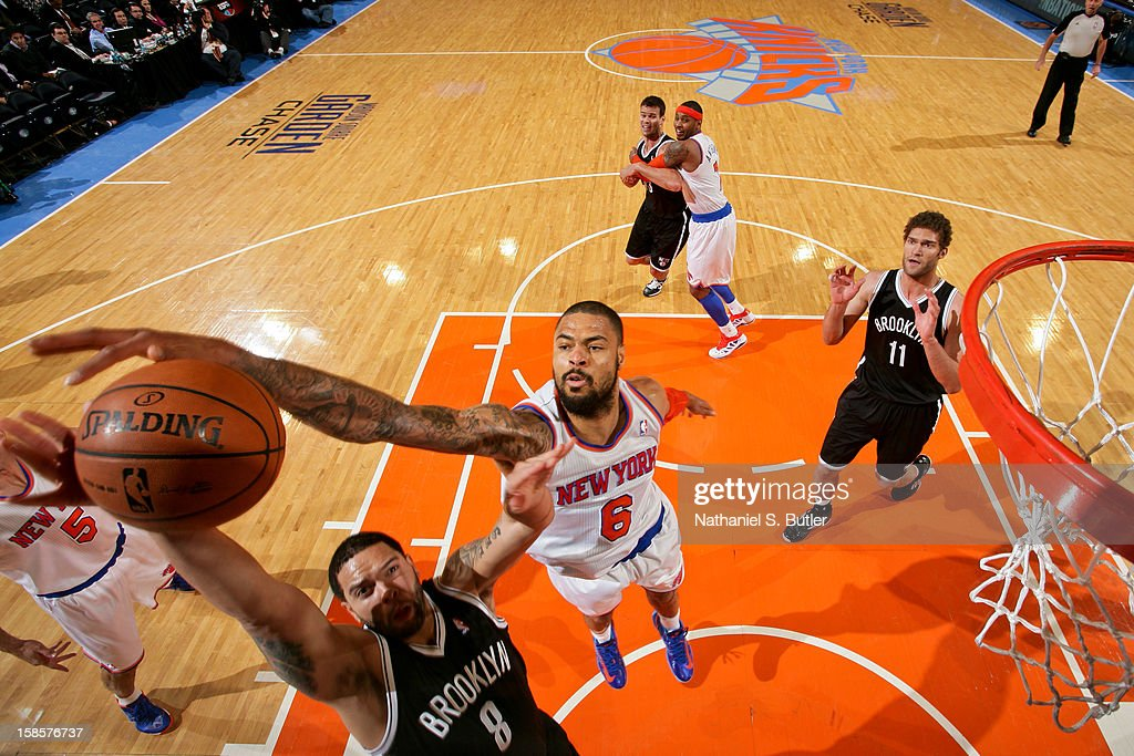 Deron Williams #8 of the Brooklyn Nets drives to the basket against Tyson Chandler #6 of the New York Knicks on December 19, 2012 at Madison Square Garden in New York City.