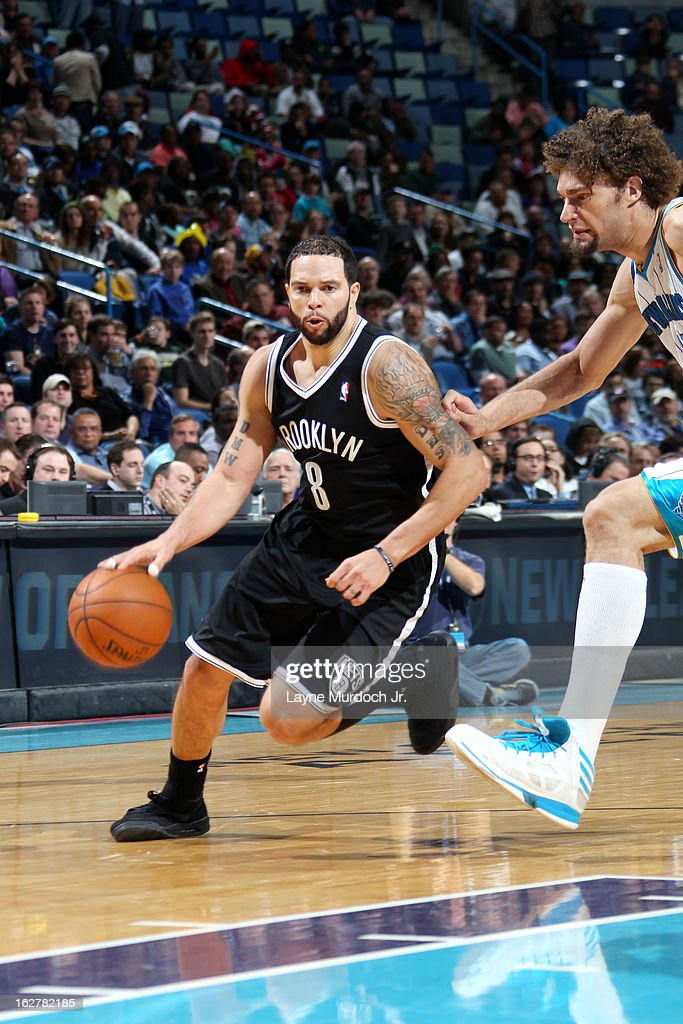 <a gi-track='captionPersonalityLinkClicked' href=/galleries/search?phrase=Deron+Williams&family=editorial&specificpeople=203215 ng-click='$event.stopPropagation()'>Deron Williams</a> #8 of the Brooklyn Nets drives to the basket against <a gi-track='captionPersonalityLinkClicked' href=/galleries/search?phrase=Robin+Lopez&family=editorial&specificpeople=2351509 ng-click='$event.stopPropagation()'>Robin Lopez</a> #15 of the New Orleans Hornets on February 26, 2013 at the New Orleans Arena in New Orleans, Louisiana.