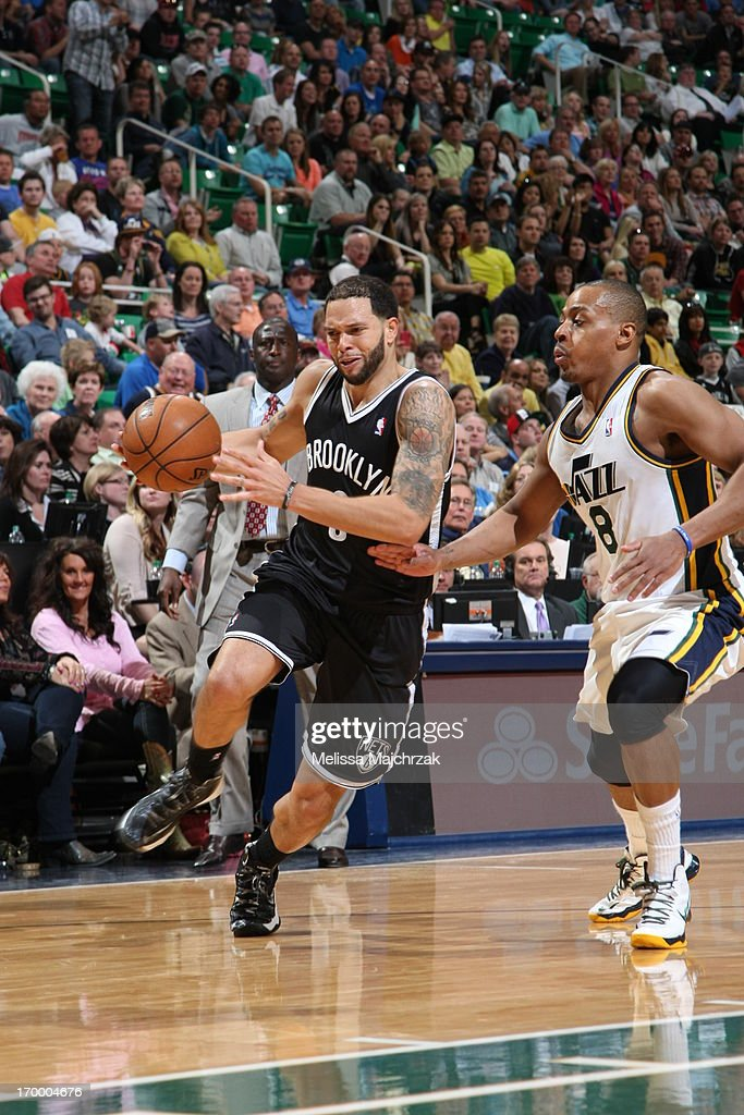 <a gi-track='captionPersonalityLinkClicked' href=/galleries/search?phrase=Deron+Williams&family=editorial&specificpeople=203215 ng-click='$event.stopPropagation()'>Deron Williams</a> #8 of the Brooklyn Nets drives to the basket against <a gi-track='captionPersonalityLinkClicked' href=/galleries/search?phrase=Randy+Foye&family=editorial&specificpeople=240185 ng-click='$event.stopPropagation()'>Randy Foye</a> #8 of the Utah Jazz at Energy Solutions Arena on March 30, 2013 in Salt Lake City, Utah.