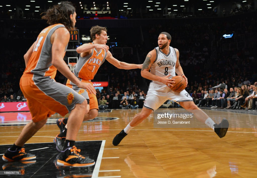 Deron Williams #8 of the Brooklyn Nets drives to the basket against the Phoenix Suns during the game at the Barclays Center on January 11, 2013 in Brooklyn, New York.