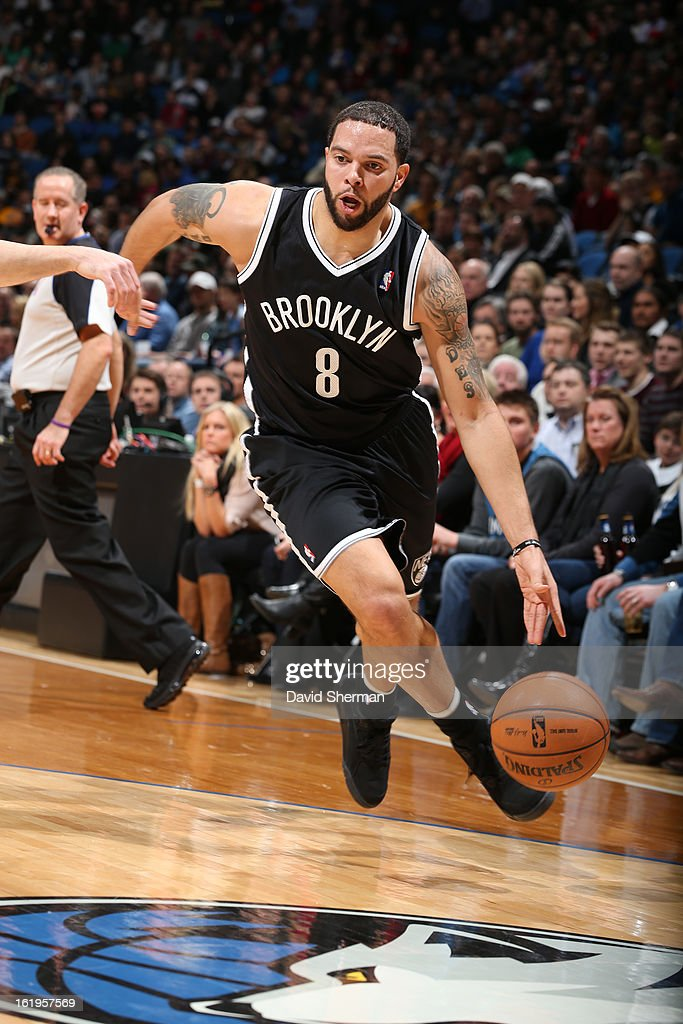 <a gi-track='captionPersonalityLinkClicked' href=/galleries/search?phrase=Deron+Williams&family=editorial&specificpeople=203215 ng-click='$event.stopPropagation()'>Deron Williams</a> #8 of the Brooklyn Nets drives to the basket against the Minnesota Timberwolves on January 23, 2013 at Target Center in Minneapolis, Minnesota.