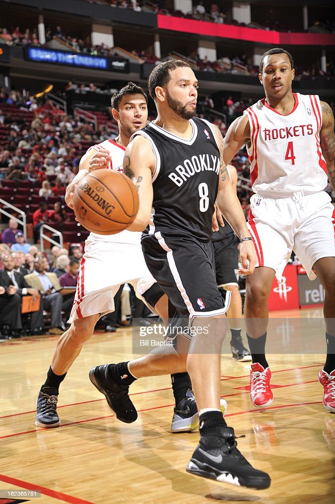 <a gi-track='captionPersonalityLinkClicked' href=/galleries/search?phrase=Deron+Williams&family=editorial&specificpeople=203215 ng-click='$event.stopPropagation()'>Deron Williams</a> #8 of the Brooklyn Nets drives to the basket against the Houston Rockets on January 26, 2013 at the Toyota Center in Houston, Texas.