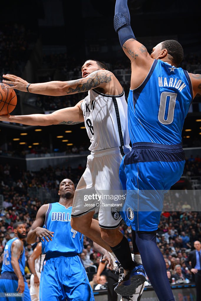 Deron Williams #8 of the Brooklyn Nets drives to the basket against the Dallas Mavericks on March 1, 2013 at the Barclays Center in Brooklyn, New York.