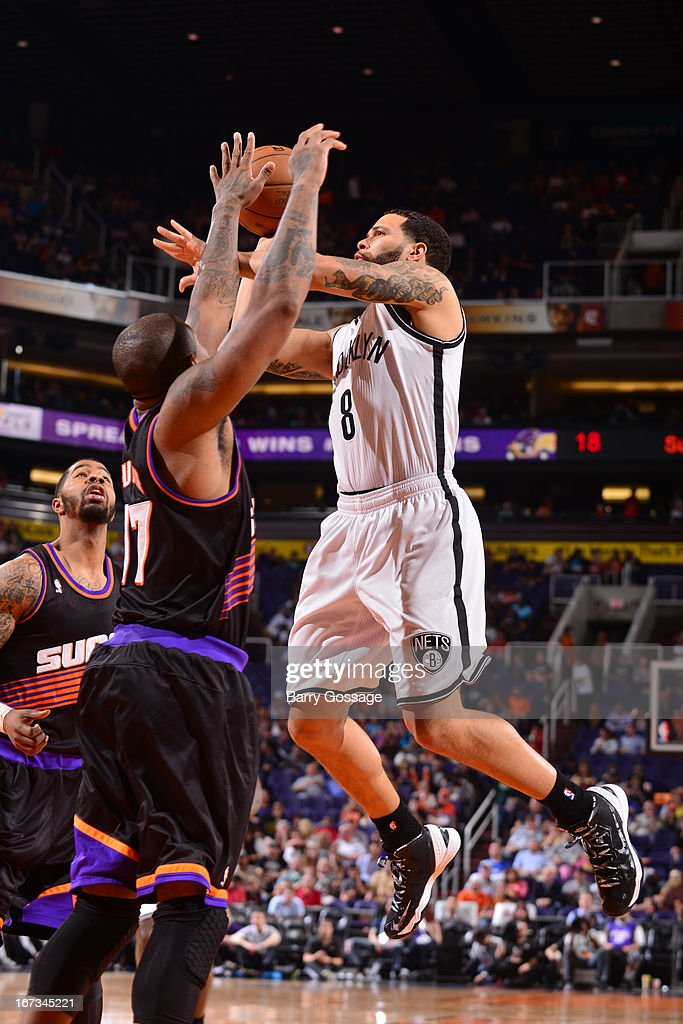 <a gi-track='captionPersonalityLinkClicked' href=/galleries/search?phrase=Deron+Williams&family=editorial&specificpeople=203215 ng-click='$event.stopPropagation()'>Deron Williams</a> #8 of the Brooklyn Nets drives to the basket against the Phoenix Suns on March 24, 2013 at U.S. Airways Center in Phoenix, Arizona.