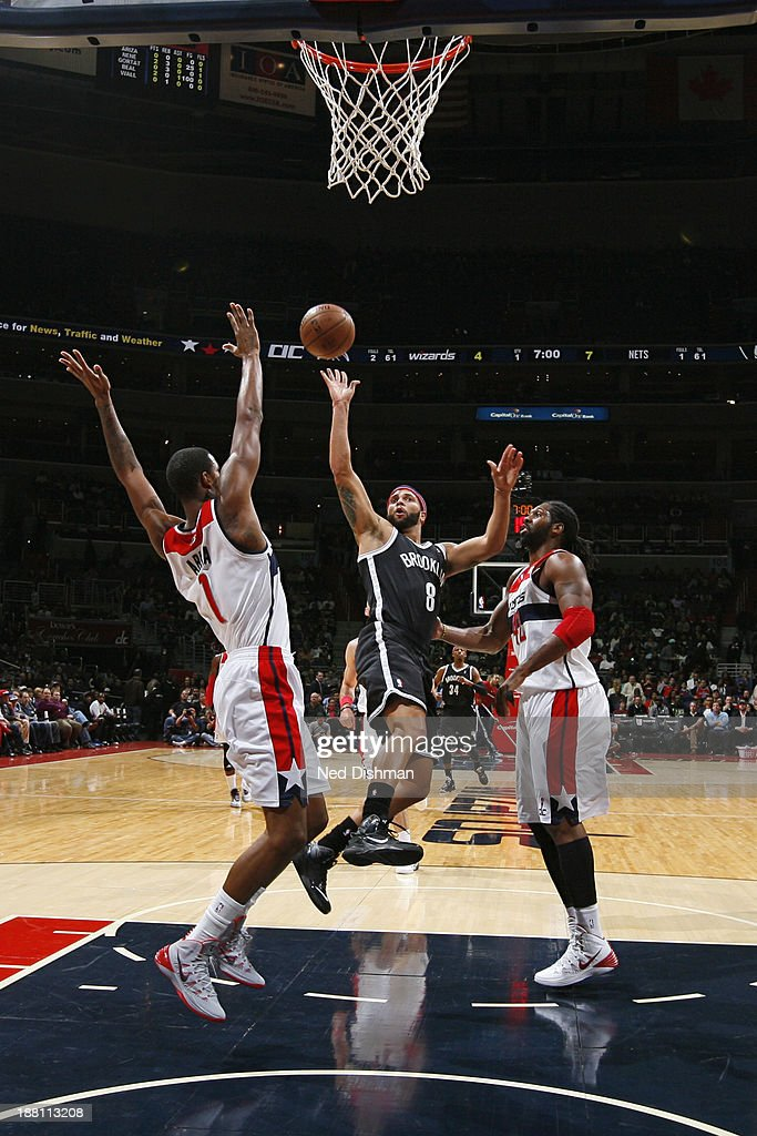 <a gi-track='captionPersonalityLinkClicked' href=/galleries/search?phrase=Deron+Williams&family=editorial&specificpeople=203215 ng-click='$event.stopPropagation()'>Deron Williams</a> #8 of the Brooklyn Nets drives to the basket against the Washington Wizards at the Verizon Center on November 8, 2013 in Washington, DC.