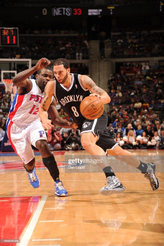 <a gi-track='captionPersonalityLinkClicked' href=/galleries/search?phrase=Deron+Williams&family=editorial&specificpeople=203215 ng-click='$event.stopPropagation()'>Deron Williams</a> #8 of the Brooklyn Nets drives to the basket against <a gi-track='captionPersonalityLinkClicked' href=/galleries/search?phrase=Will+Bynum&family=editorial&specificpeople=212891 ng-click='$event.stopPropagation()'>Will Bynum</a> #12 of the Detroit Pistons on March 18, 2013 at The Palace of Auburn Hills in Auburn Hills, Michigan.