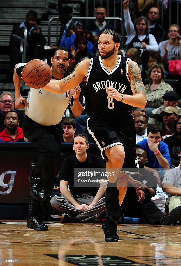 <a gi-track='captionPersonalityLinkClicked' href=/galleries/search?phrase=Deron+Williams&family=editorial&specificpeople=203215 ng-click='$event.stopPropagation()'>Deron Williams</a> #8 of the Brooklyn Nets drives up-court against the Atlanta Hawks on January 16, 2013 at Philips Arena in Atlanta, Georgia.