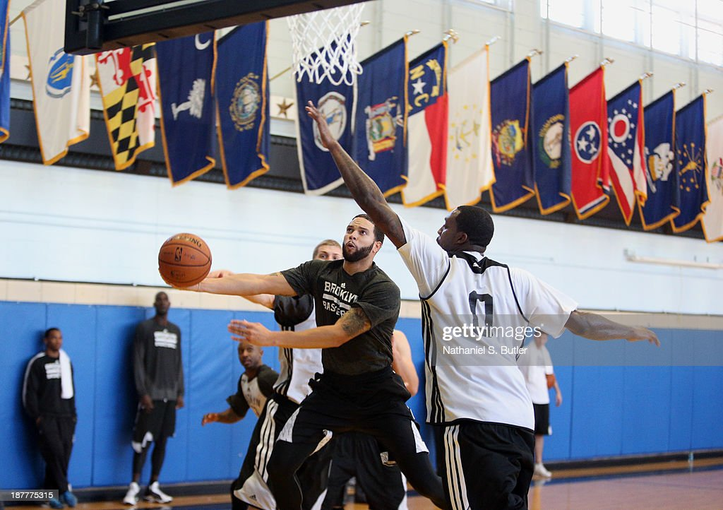 Deron Williams #8 of the Brooklyn Nets during a team event in celebration of Veterans Day at Ft. Hamilton, Brooklyn on November 11, 2013 in the Brooklyn borough of New York City.