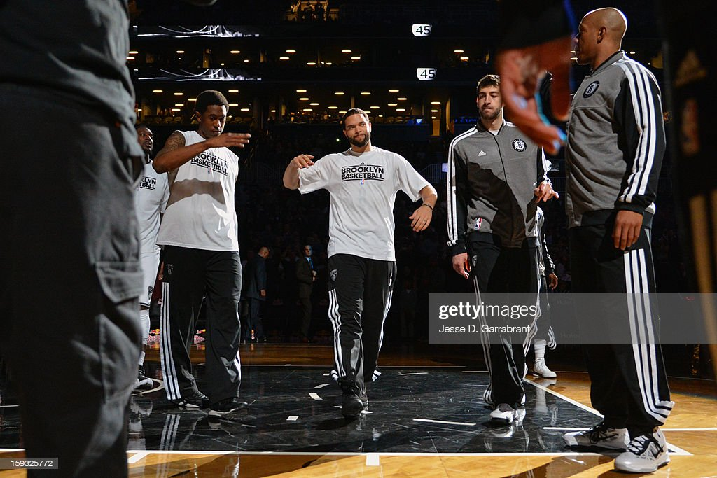 Deron Williams #8 of The Brooklyn Nets enter the court before their game against the Phoenix Suns at the Barclays Center on January 11, 2013 in Brooklyn, New York.
