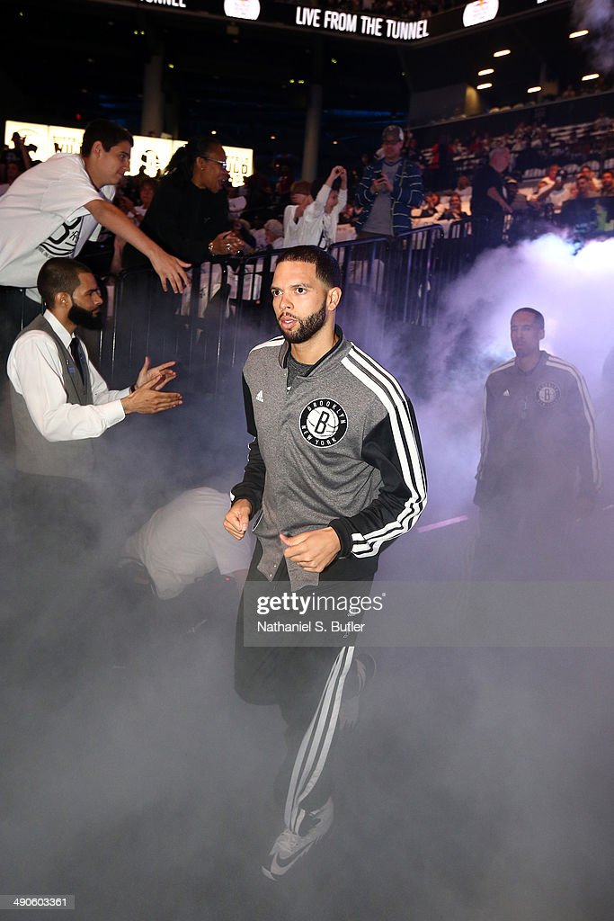 <a gi-track='captionPersonalityLinkClicked' href=/galleries/search?phrase=Deron+Williams&family=editorial&specificpeople=203215 ng-click='$event.stopPropagation()'>Deron Williams</a> #8 of the Brooklyn Nets gets introduced before a game against the Miami Heat during Game Three of the Eastern Conference Semifinals on May 10, 2014 at Barclays Center in Brooklyn.