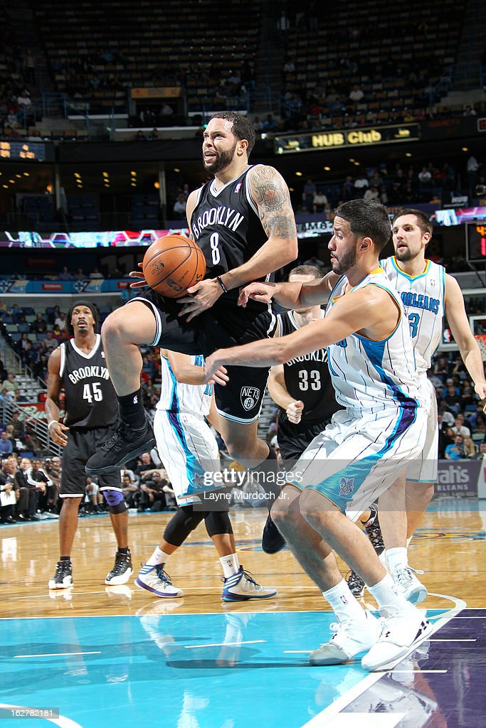 <a gi-track='captionPersonalityLinkClicked' href=/galleries/search?phrase=Deron+Williams&family=editorial&specificpeople=203215 ng-click='$event.stopPropagation()'>Deron Williams</a> #8 of the Brooklyn Nets goes to the basket against <a gi-track='captionPersonalityLinkClicked' href=/galleries/search?phrase=Greivis+Vasquez&family=editorial&specificpeople=4066977 ng-click='$event.stopPropagation()'>Greivis Vasquez</a> #21 of the New Orleans Hornets on February 26, 2013 at the New Orleans Arena in New Orleans, Louisiana.