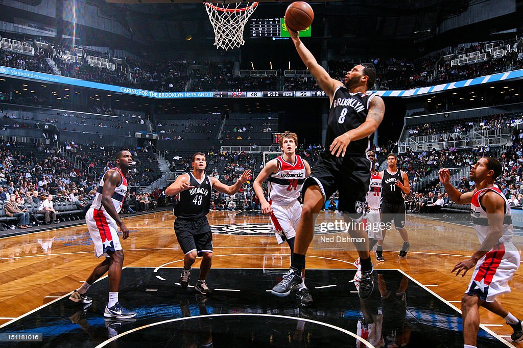 <a gi-track='captionPersonalityLinkClicked' href=/galleries/search?phrase=Deron+Williams&family=editorial&specificpeople=203215 ng-click='$event.stopPropagation()'>Deron Williams</a> #8 of the Brooklyn Nets goes to the basket against the Washington Wizards at the Barclays Center on October 15, 2012 in the Brooklyn borough of New York City.