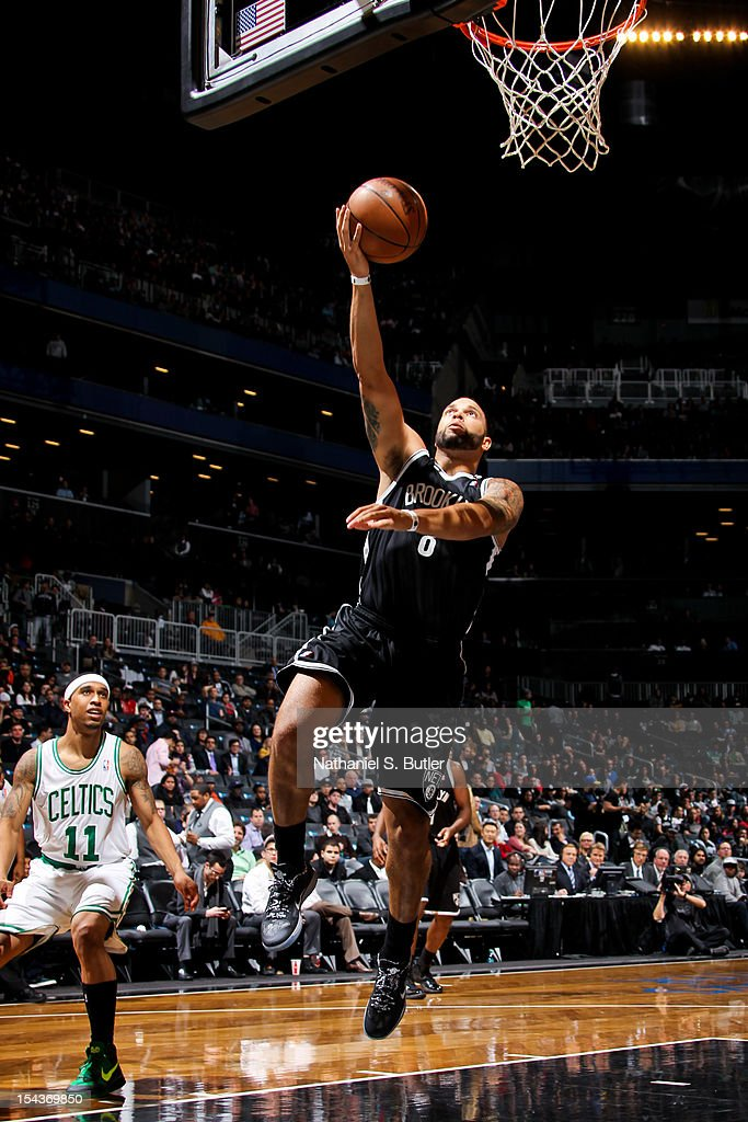 Deron Williams #8 of the Brooklyn Nets goes to the basket against the Boston Celtics during a pre-season game on October 18, 2012 at the Barclays Center in the Brooklyn borough of New York City.