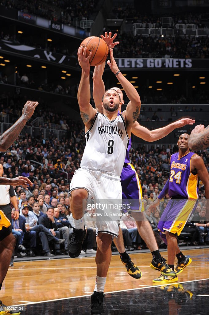 Deron Williams #8 of the Brooklyn Nets goes to the basket against the Los Angeles Lakers on February 5, 2013 at the Barclays Center in the Brooklyn borough of New York City.