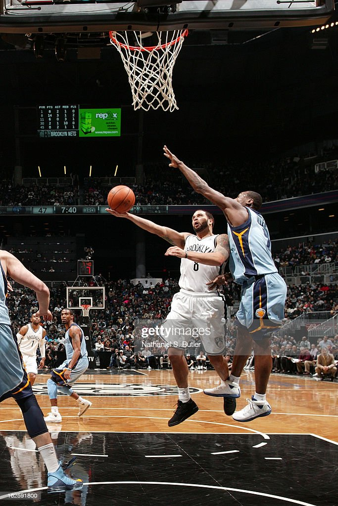 <a gi-track='captionPersonalityLinkClicked' href=/galleries/search?phrase=Deron+Williams&family=editorial&specificpeople=203215 ng-click='$event.stopPropagation()'>Deron Williams</a> #8 of the Brooklyn Nets goes to the basket against <a gi-track='captionPersonalityLinkClicked' href=/galleries/search?phrase=Tony+Allen+-+Basketball+Player&family=editorial&specificpeople=201665 ng-click='$event.stopPropagation()'>Tony Allen</a> #9 of the Memphis Grizzlies on February 24, 2013 at the Barclays Center in the Brooklyn borough of New York City.