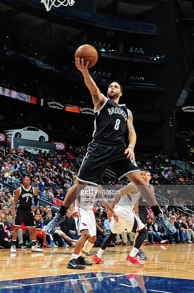Deron Williams #8 of the Brooklyn Nets goes up for the easy bucket against the Atlanta Hawks on March 9, 2013 at Philips Arena in Atlanta, Georgia.