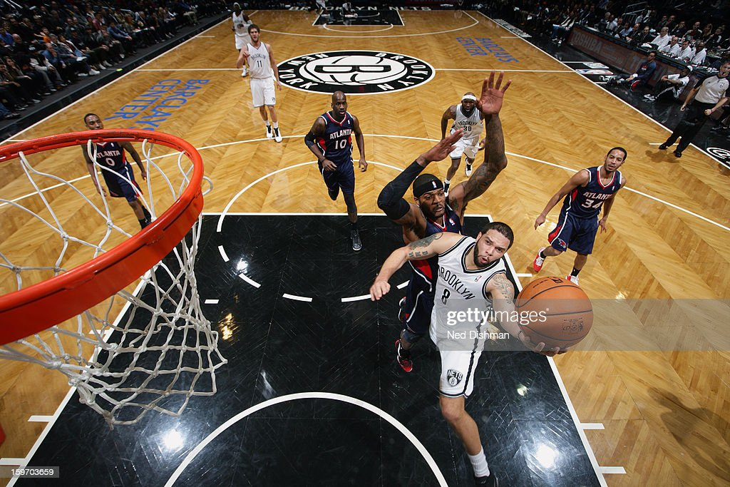 Deron Williams #8 of the Brooklyn Nets goes up for the easy layup against the Atlanta Hawks at the Barclays Center on January 18, 2013 in the Brooklyn borough of New York City in New York City.