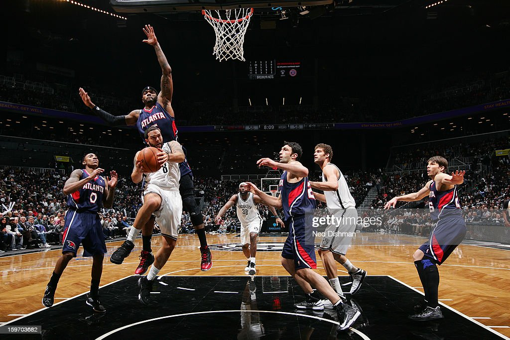<a gi-track='captionPersonalityLinkClicked' href=/galleries/search?phrase=Deron+Williams&family=editorial&specificpeople=203215 ng-click='$event.stopPropagation()'>Deron Williams</a> #8 of the Brooklyn Nets goes up for the layup against the Atlanta Hawks at the Barclays Center on January 18, 2013 in the Brooklyn borough of New York City in New York City.