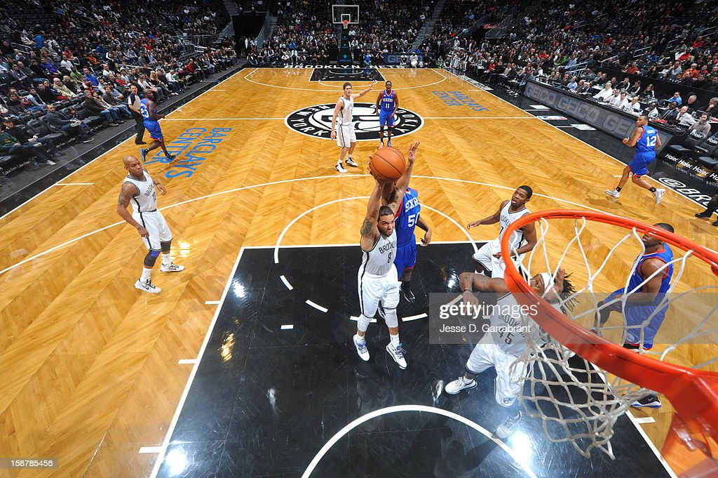 <a gi-track='captionPersonalityLinkClicked' href=/galleries/search?phrase=Deron+Williams&family=editorial&specificpeople=203215 ng-click='$event.stopPropagation()'>Deron Williams</a> #8 of the Brooklyn Nets grabs a rebound against the Philadelphia 76ers at the Barclays Center on December 23, 2012 in Brooklyn, New York.