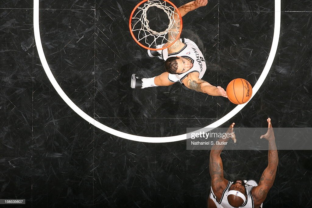 <a gi-track='captionPersonalityLinkClicked' href=/galleries/search?phrase=Deron+Williams&family=editorial&specificpeople=203215 ng-click='$event.stopPropagation()'>Deron Williams</a> #8 of the Brooklyn Nets grabs a rebound against the New York Knicks on November 26, 2012 at the Barclays Center in the Brooklyn Borough of New York City.