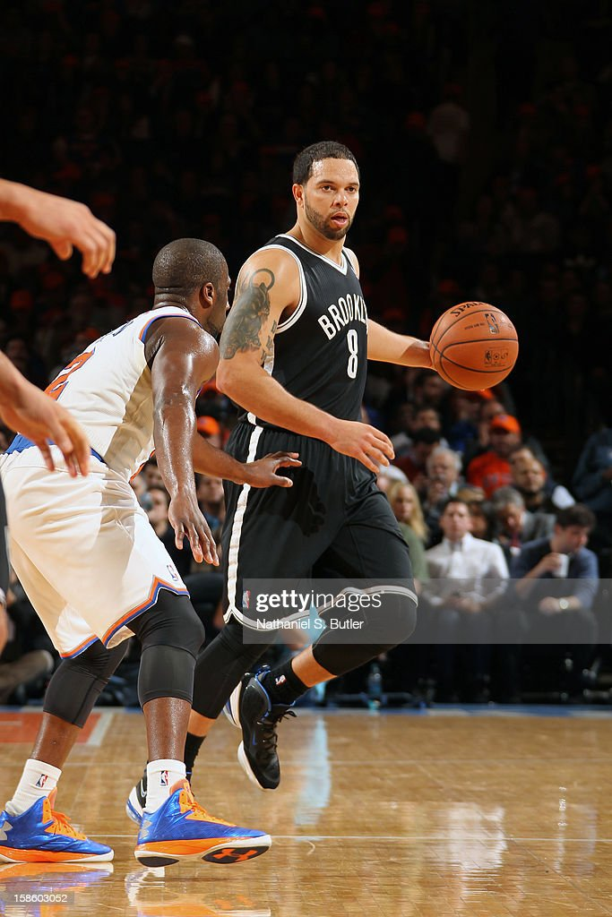 Deron Williams #8 of the Brooklyn Nets handles the ball against Raymond Felton #2 of the New York Knick on December 19, 2012 at Madison Square Garden in New York City.