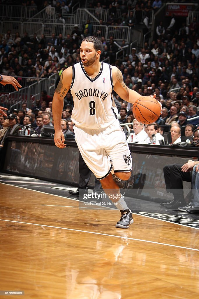 <a gi-track='captionPersonalityLinkClicked' href=/galleries/search?phrase=Deron+Williams&family=editorial&specificpeople=203215 ng-click='$event.stopPropagation()'>Deron Williams</a> #8 of the Brooklyn Nets handles the ball against the Oklahoma City Thunder on December 4, 2012 at the Barclays Center in the Brooklyn Borough of New York City.
