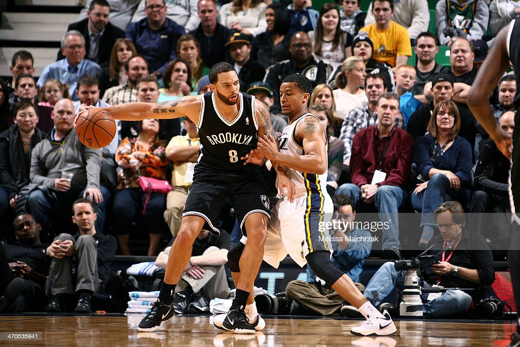 <a gi-track='captionPersonalityLinkClicked' href=/galleries/search?phrase=Deron+Williams&family=editorial&specificpeople=203215 ng-click='$event.stopPropagation()'>Deron Williams</a> #8 of the Brooklyn Nets handles the ball against Trey Burke #3 of the Utah Jazz at EnergySolutions Arena on February 19, 2014 in Salt Lake City, Utah.