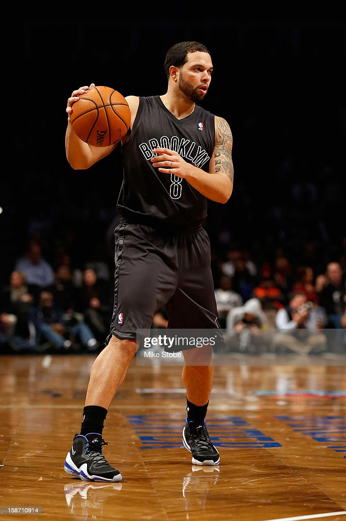Deron Williams #8 of the Brooklyn Nets handles the ball during the game against the Boston Celtics at the Barclays Center on December 25, 2012 in the Brooklyn borough of New York City.