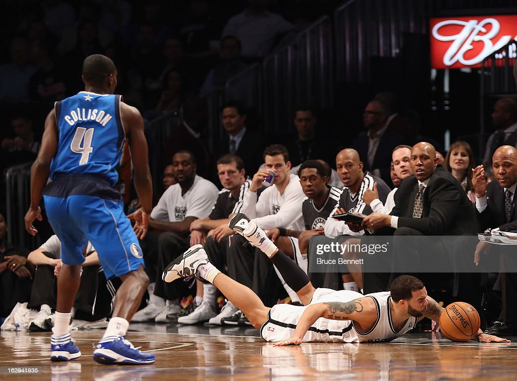 Deron Williams #8 of the Brooklyn Nets hits the floor during the second half against the Dallas Mavericks at the Barclays Center on March 1, 2013 in New York City.