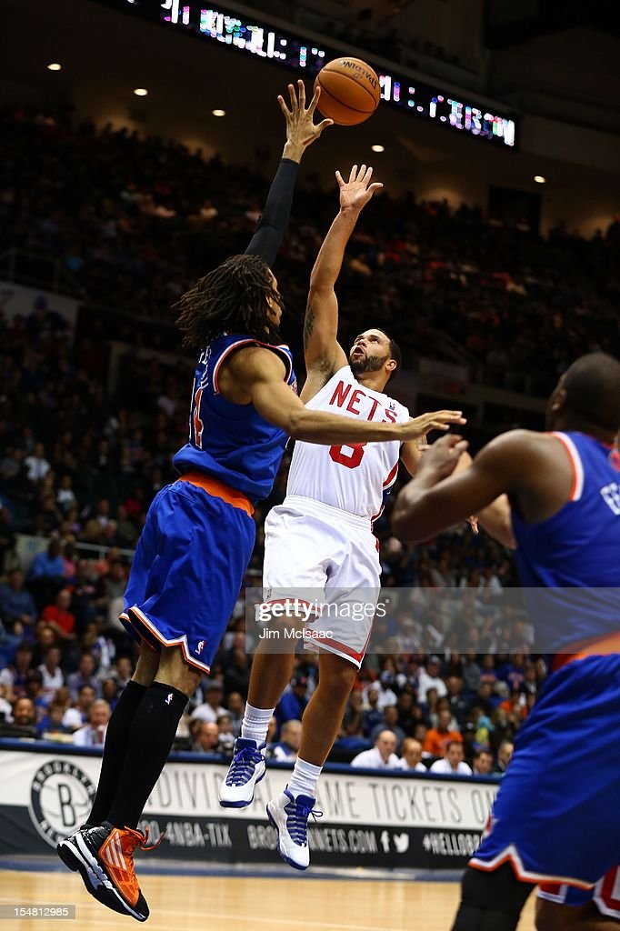 Deron Williams #8 of the Brooklyn Nets in action against Chris Copeland #14 of the New York Knicks during a preseason game at Nassau Coliseum on October 24 2012 in Uniondale, New York The Knicks defeated the Nets 97-95.