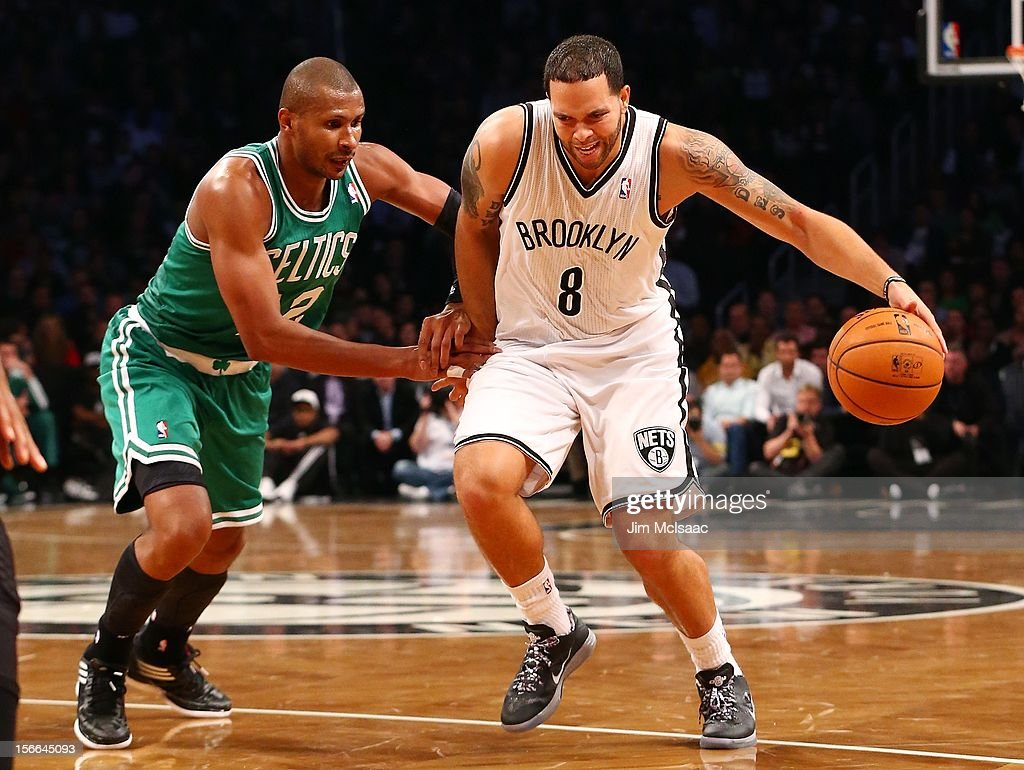 Deron Williams #8 of the Brooklyn Nets in action against Leandro Barbosa #12 of the Boston Celtics at Barclays Center on November 15, 2012 in the Brooklyn borough of New York City.The Nets defeated the Celtics 102-97.