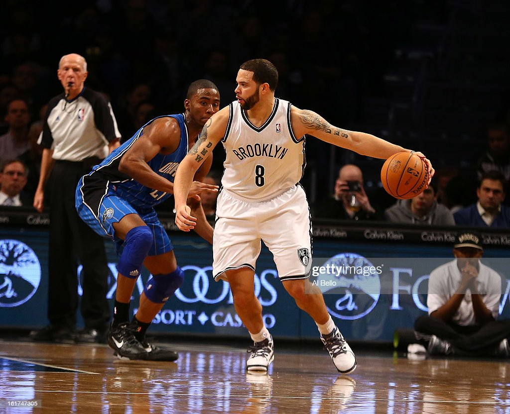 <a gi-track='captionPersonalityLinkClicked' href=/galleries/search?phrase=Deron+Williams&family=editorial&specificpeople=203215 ng-click='$event.stopPropagation()'>Deron Williams</a> #8 of the Brooklyn Nets in action against <a gi-track='captionPersonalityLinkClicked' href=/galleries/search?phrase=Moe+Harkless&family=editorial&specificpeople=8653497 ng-click='$event.stopPropagation()'>Moe Harkless</a> #21 of the Orlando Magic during their game at the Barclays Center on January 28, 2013 in the Brooklyn borough of New York City.