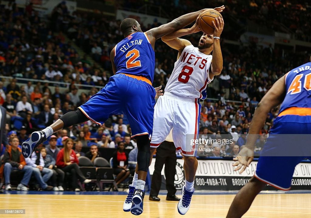 Deron Williams #8 of the Brooklyn Nets in action against Raymond Felton #2 of the New York Knicks during a preseason game at Nassau Coliseum on October 24 2012 in Uniondale, New York The Knicks defeated the Nets 97-95.