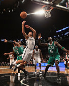 Deron Williams of the Brooklyn Nets is fouled by Leandro Barbosa of the Boston Celtics at the Barclays Center on November 15 2012 in the Brooklyn...