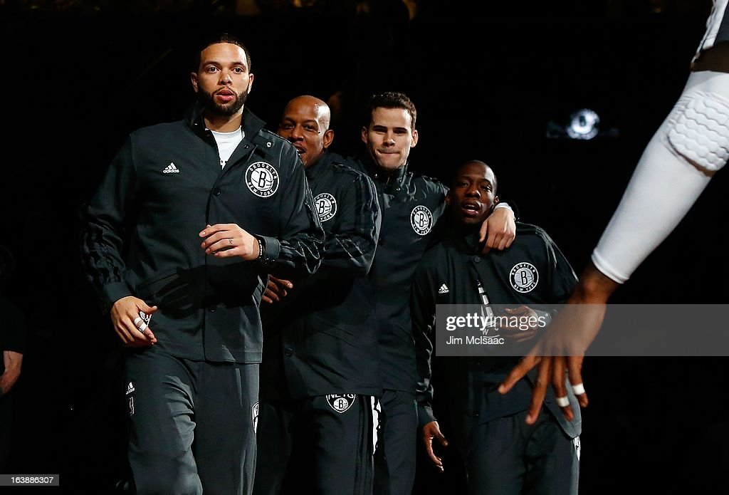 Deron Williams #8 of the Brooklyn Nets is introduced before a game against the Dallas Mavericks with teammates Keith Bogans #10 (2nd L), Kris Humphries #43 and Tyshawn Taylor #41 (R) at Barclays Center on March 1, 2013 in the Brooklyn borough of New York City.The Mavericks defeated the Nets 98-90.