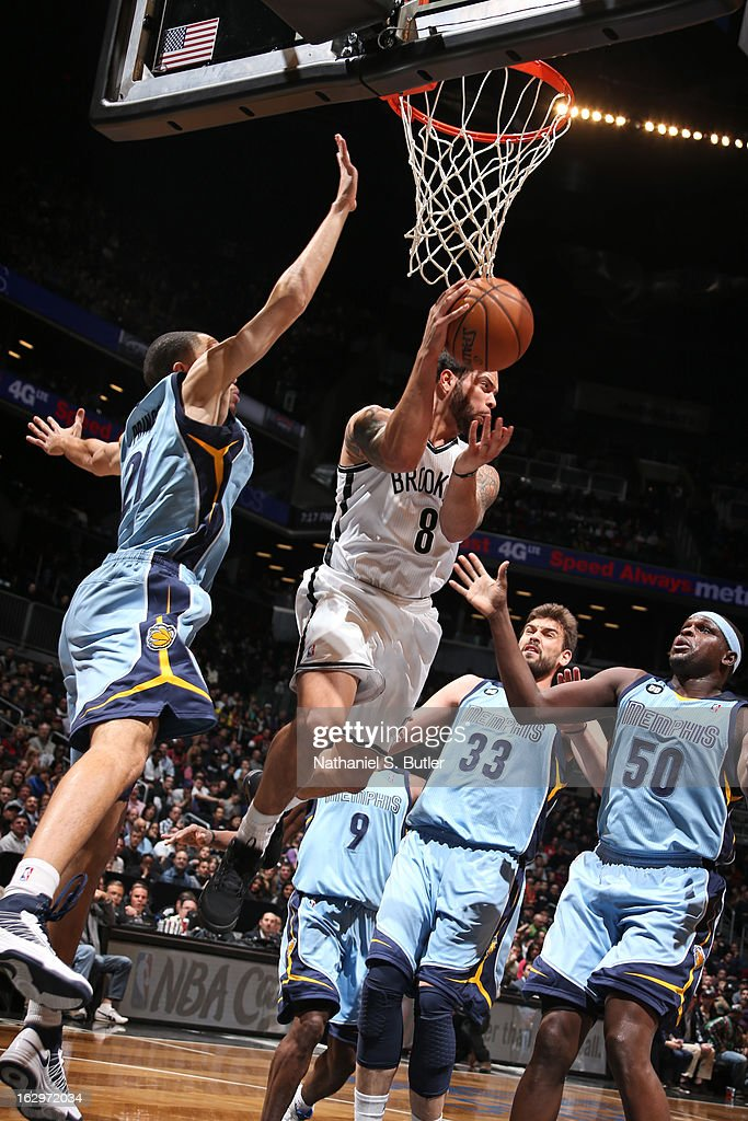 <a gi-track='captionPersonalityLinkClicked' href=/galleries/search?phrase=Deron+Williams&family=editorial&specificpeople=203215 ng-click='$event.stopPropagation()'>Deron Williams</a> #8 of the Brooklyn Nets kicks the ball out to the top of the key in traffic against the Memphis Grizzlies on February 24, 2013 at the Barclays Center in the Brooklyn borough of New York City.
