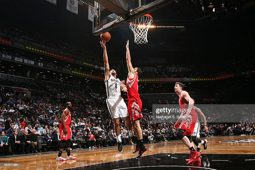 <a gi-track='captionPersonalityLinkClicked' href=/galleries/search?phrase=Deron+Williams&family=editorial&specificpeople=203215 ng-click='$event.stopPropagation()'>Deron Williams</a> #8 of the Brooklyn Nets lays the ball in the basket during the game against the Houston Rockets at the Barclays Center on April 01, 2014 in the Brooklyn borough of New York City.