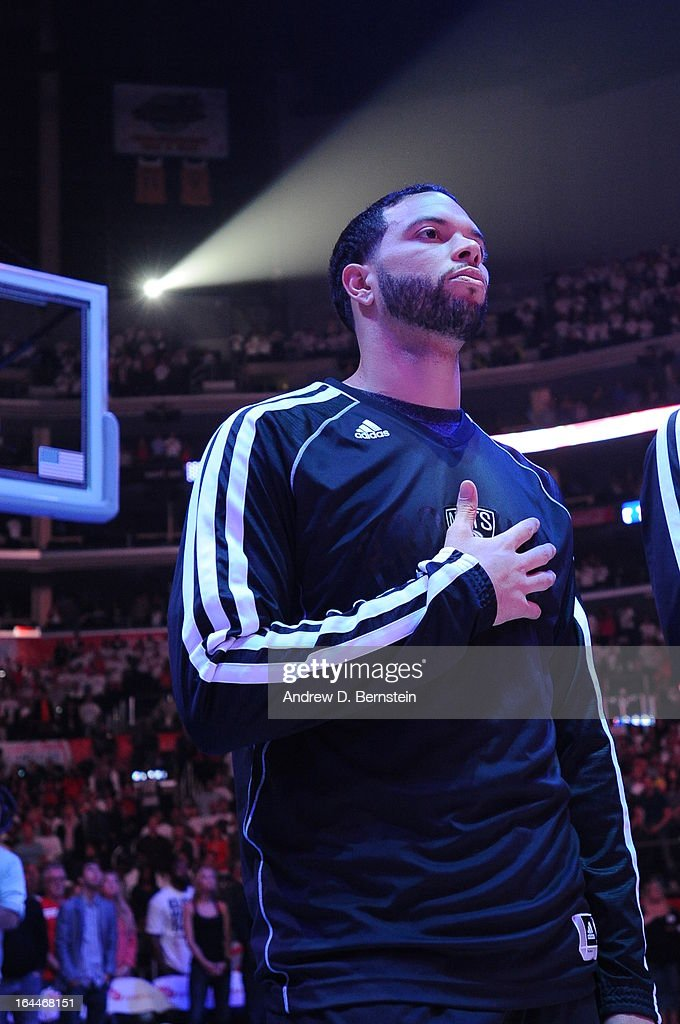 Deron Williams #8 of the Brooklyn Nets lines up for a National Anthem during the game between the Los Angeles Clippers and the Brooklyn Nets at Staples Center on March 23, 2013 in Los Angeles, California.