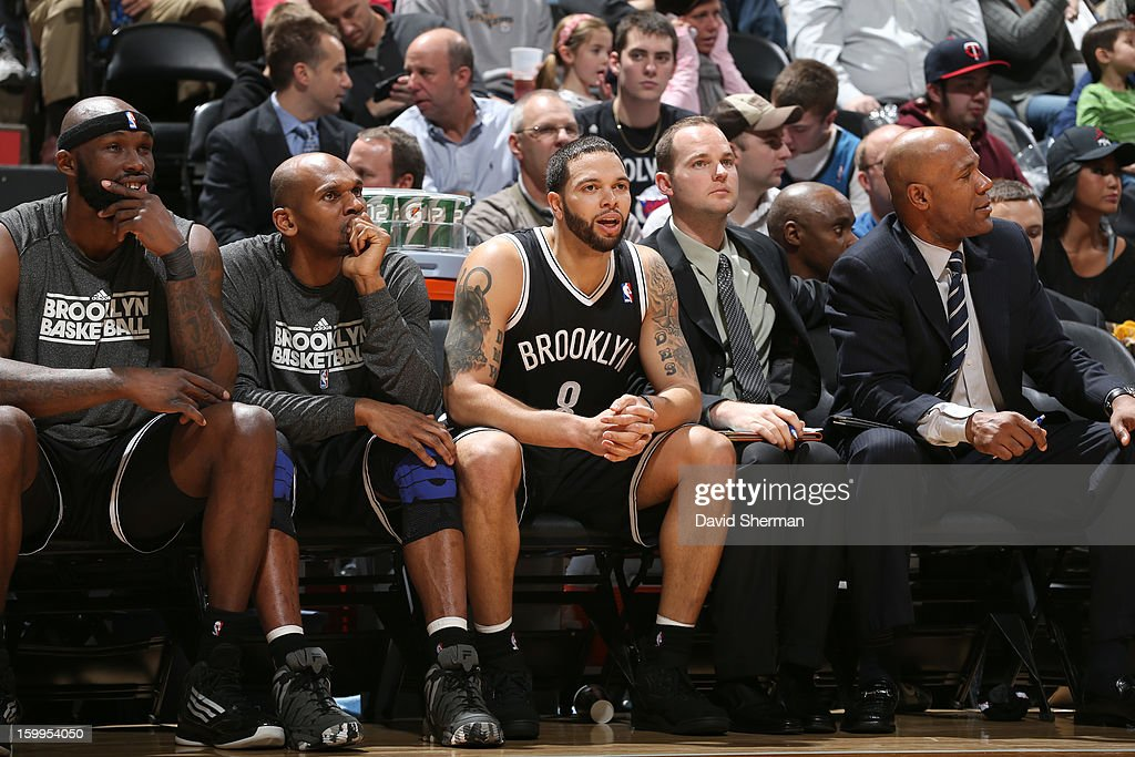 Deron Williams #8 of the Brooklyn Nets looks on from the bench during the game between the Minnesota Timberwolves and the Brooklyn Nets on January 23, 2013 at Target Center in Minneapolis, Minnesota.