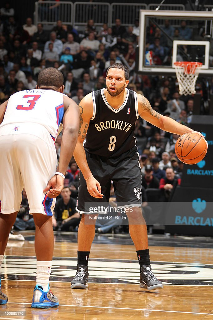 <a gi-track='captionPersonalityLinkClicked' href=/galleries/search?phrase=Deron+Williams&family=editorial&specificpeople=203215 ng-click='$event.stopPropagation()'>Deron Williams</a> #8 of the Brooklyn Nets looks to pass against <a gi-track='captionPersonalityLinkClicked' href=/galleries/search?phrase=Chris+Paul&family=editorial&specificpeople=212762 ng-click='$event.stopPropagation()'>Chris Paul</a> #3 of the Los Angeles Clippers on November 23, 2012 at the Barclays Center in the Brooklyn Borough of New York City.