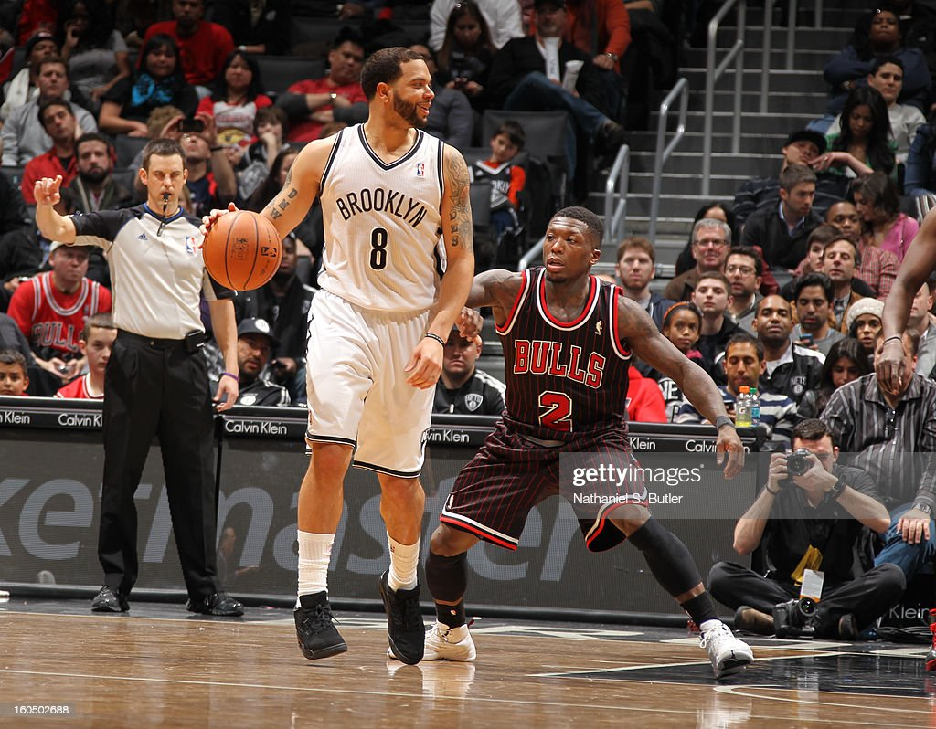 <a gi-track='captionPersonalityLinkClicked' href=/galleries/search?phrase=Deron+Williams&family=editorial&specificpeople=203215 ng-click='$event.stopPropagation()'>Deron Williams</a> #8 of the Brooklyn Nets looks to pass the ball against the Chicago Bulls on February 1, 2013 at the Barclays Center in the Brooklyn borough of New York City.