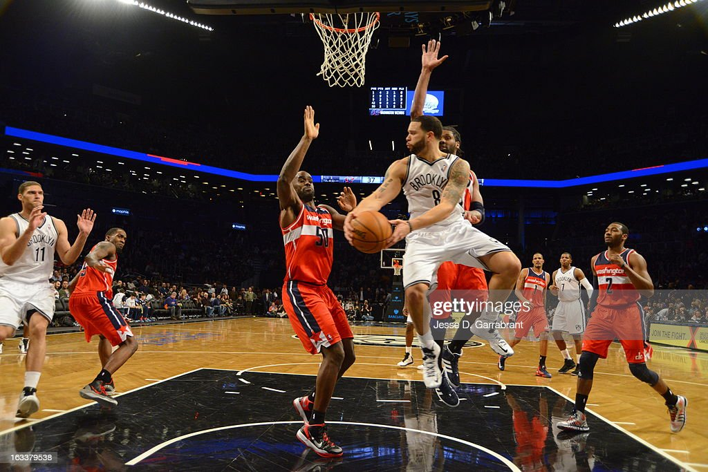 <a gi-track='captionPersonalityLinkClicked' href=/galleries/search?phrase=Deron+Williams&family=editorial&specificpeople=203215 ng-click='$event.stopPropagation()'>Deron Williams</a> #8 of the Brooklyn Nets looks to pass the ball against the Washington Wizards on March 8, 2013 at the Barclays Center in Brooklyn, New York.