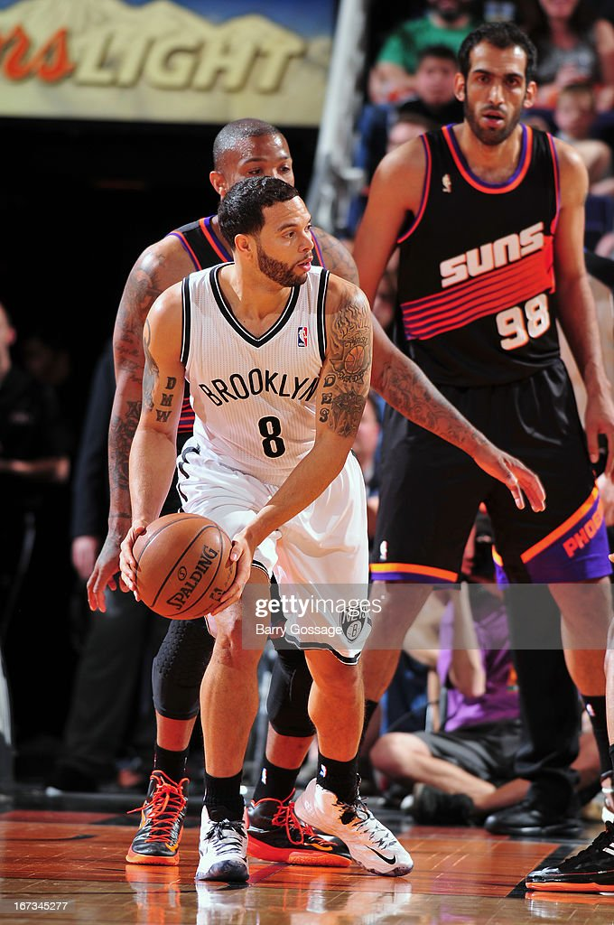 <a gi-track='captionPersonalityLinkClicked' href=/galleries/search?phrase=Deron+Williams&family=editorial&specificpeople=203215 ng-click='$event.stopPropagation()'>Deron Williams</a> #8 of the Brooklyn Nets looks to pass the ball against the Phoenix Suns on March 24, 2013 at U.S. Airways Center in Phoenix, Arizona.