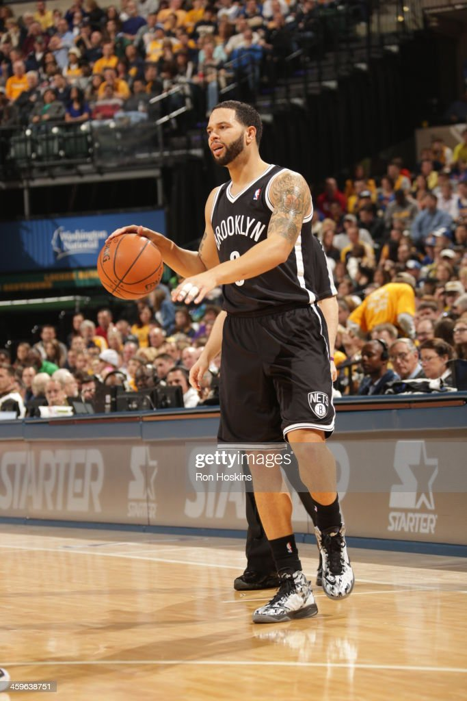 <a gi-track='captionPersonalityLinkClicked' href=/galleries/search?phrase=Deron+Williams&family=editorial&specificpeople=203215 ng-click='$event.stopPropagation()'>Deron Williams</a> #8 of the Brooklyn Nets looks to pass the ball against the Indiana Pacers at Bankers Life Fieldhouse on December 28, 2013 in Indianapolis, Indiana.