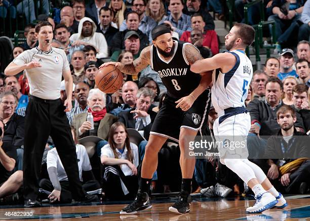 Deron Williams of the Brooklyn Nets posts up against Jose Juan Barea of the Dallas Mavericks on February 28 2015 at the American Airlines Center in...