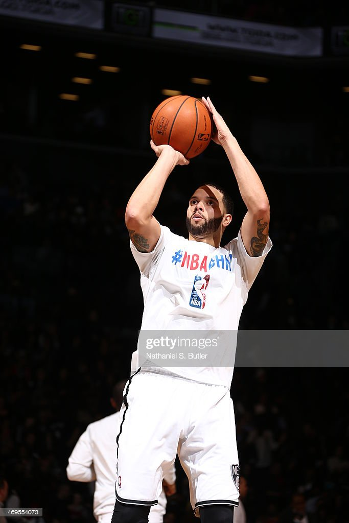 <a gi-track='captionPersonalityLinkClicked' href=/galleries/search?phrase=Deron+Williams&family=editorial&specificpeople=203215 ng-click='$event.stopPropagation()'>Deron Williams</a> #8 of the Brooklyn Nets practices before the game against the San Antonio Spurs at the Barclays Center on February 06, 2014 in the Brooklyn borough of New York City.
