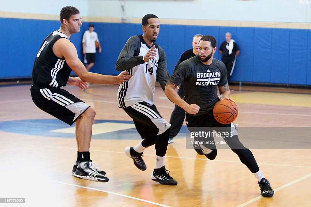 Deron Williams #8 of the Brooklyn Nets practices during a team event in celebration of Veterans Day at Ft. Hamilton, Brooklyn on November 11, 2013 in the Brooklyn borough of New York City.