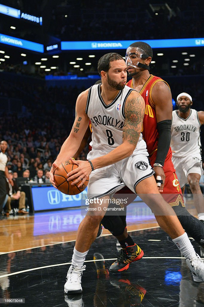 Deron Williams #8 of the Brooklyn Nets protects the ball against Kyrie Irving #2 of the Cleveland Cavaliers at the Barclays Center on December 29, 2012 in Brooklyn, New York.