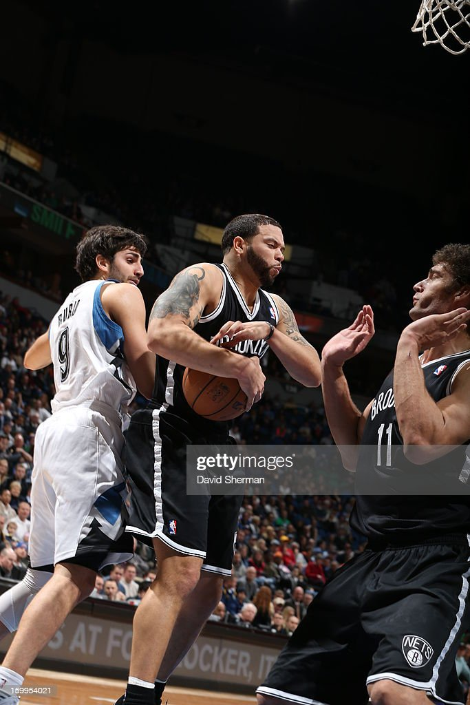 Deron Williams #8 of the Brooklyn Nets protects the ball from Ricky Rubio #9 of the Minnesota Timberwolves during the game between the Minnesota Timberwolves and the Brooklyn Nets on January 23, 2013 at Target Center in Minneapolis, Minnesota.