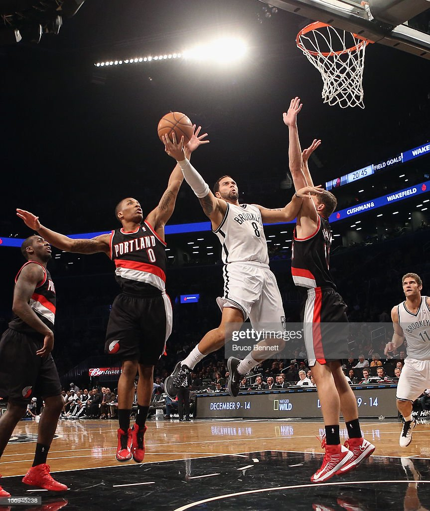<a gi-track='captionPersonalityLinkClicked' href=/galleries/search?phrase=Deron+Williams&family=editorial&specificpeople=203215 ng-click='$event.stopPropagation()'>Deron Williams</a> #8 of the Brooklyn Nets scores two late in the fourth quarter against the Portland Trail Blazers at the Barclays Center on November 25, 2012 in the Brooklyn borough of New York City.